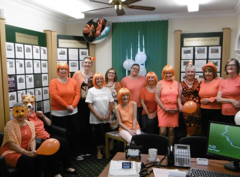 AGENT GOES ORANGE FOR A GOOD CAUSE